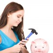 Teenage girl with piggy bank and hammer — Stock Photo #5524891