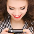 Happy teenage girl with digital camera — Stock Photo #5524927