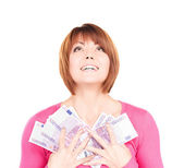 Happy woman with money — Stock Photo