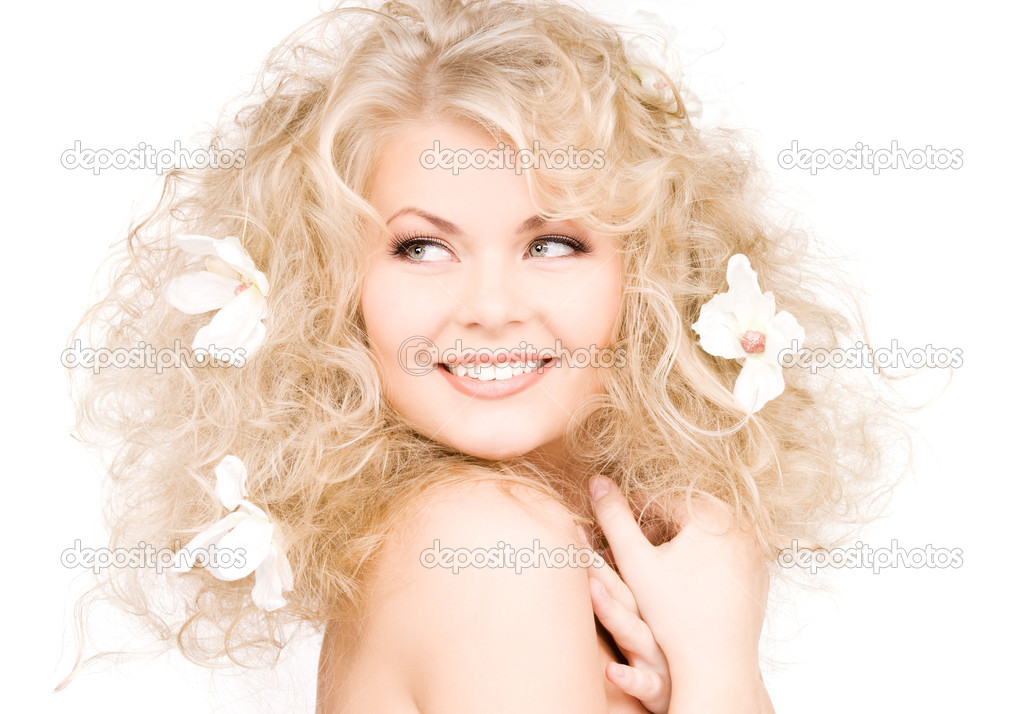 Picture of happy woman with flowers in hair — Stock fotografie #5524865