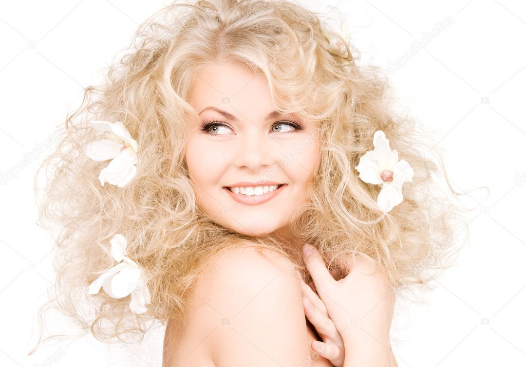 Picture of happy woman with flowers in hair — Photo #5524865