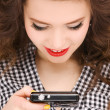 Happy teenage girl with digital camera — Stock Photo