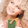 Happy girl with gift box — Stock Photo