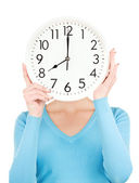 Woman with big clock covering face — Stock Photo