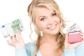 Lovely woman with purse and money — Stockfoto