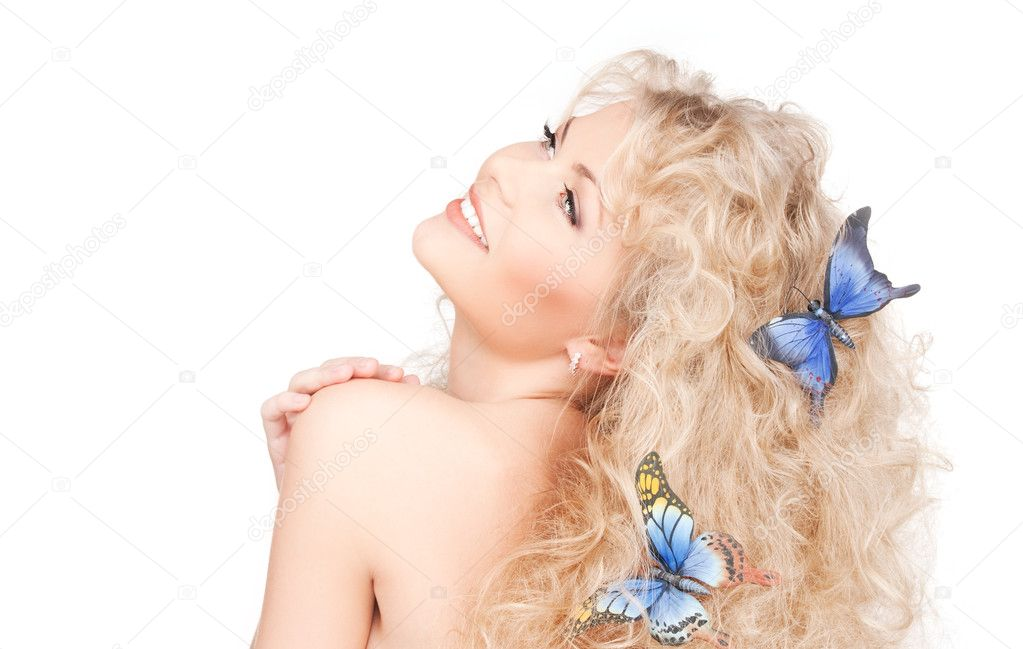 Picture of happy woman with butterflies in hair — Lizenzfreies Foto #5532878