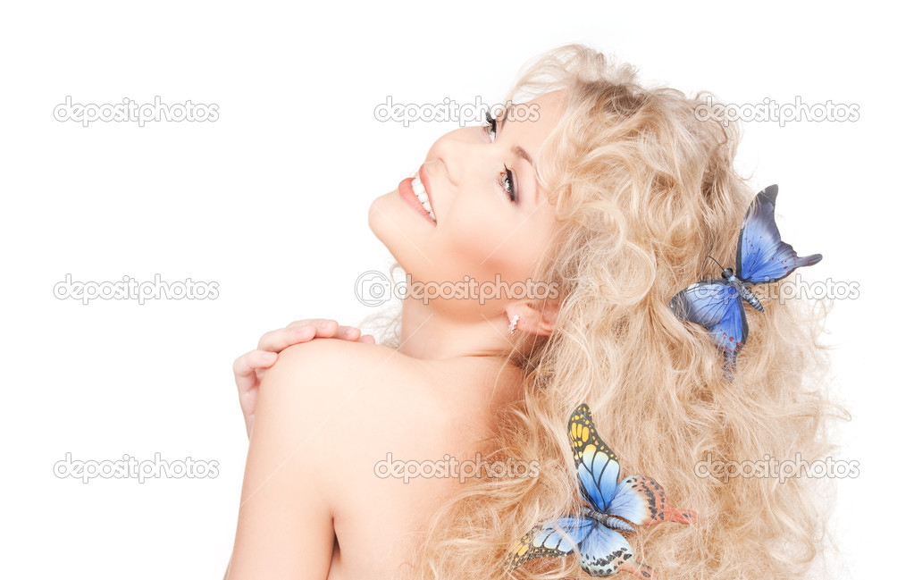 Picture of happy woman with butterflies in hair — Foto Stock #5532878