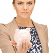 Stock Photo: Lovely woman with piggy bank