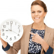 Stock Photo: Woman holding big clock