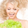 Happy woman with lettuce — Stock Photo #5557878