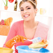 Housewife washing dish — Stockfoto