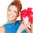 Stock Photo: Happy girl with gift box