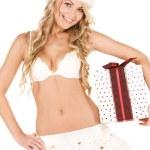 Cheerful santa helper girl with gift box — Stock Photo
