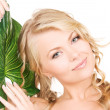 Stock Photo: Woman with green leaf