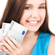 Lovely teenage girl with money — Stock Photo #5558452