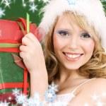 Happy santa helper with gift box — Stock Photo #5558457