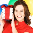 Woman with gift box and balloons — Stock Photo