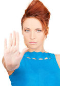 Young woman making stop gesture — Stock Photo