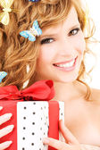 Butterfly girl with gift — Stock Photo