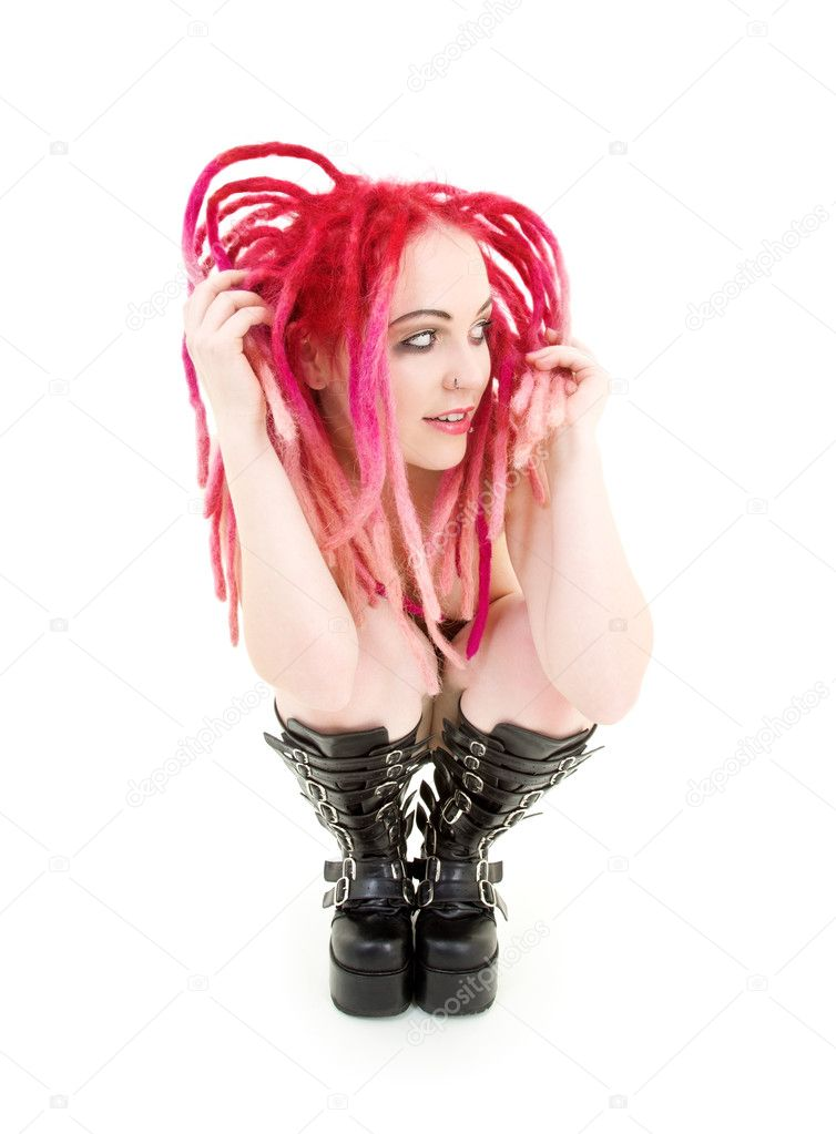 Picture of bizarre pink hair girl in high boots — Stock Photo #5558324