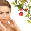 Lovely woman with apple twig — Stock Photo #5563466