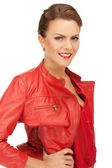 Lovely woman in red leather jacket — Stock Photo