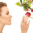 Lovely woman with apple twig — Stock Photo #5592696