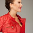 Lovely woman in red leather jacket — Stock Photo #5592742