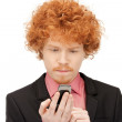 Handsome man with cell phone — Stock Photo