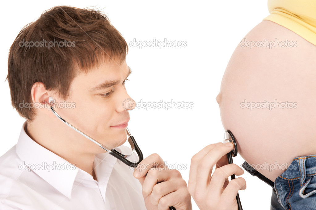 Bright closeup picture of doctor and pregnant woman belly — Stock Photo #5664931