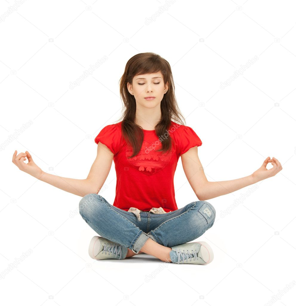 Bright picture of calm attractive teenage girl in lotus pose  Stock Photo #5665164
