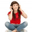 Happy teenage girl in big headphones — Stock Photo #5689836