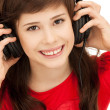 Happy teenage girl in big headphones — Stock Photo #5689853