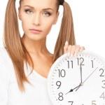 Woman holding big clock — Stock Photo #5689911