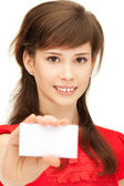 Teenage girl with business card — Stock Photo