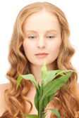 Woman with green sprout — Stock Photo