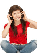 Happy teenage girl in big headphones — Stock Photo