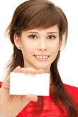 Teenage girl with business card — Stock Photo