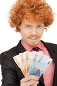 Handsome man with euro cash money — Stock Photo