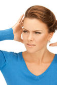 Woman with hands on ears — Stockfoto