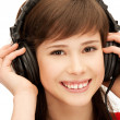 Happy teenage girl in big headphones — Stockfoto #5828260