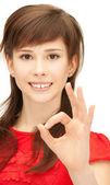 Güzel genç kız ok işareti gösteriliyor — Stok fotoğraf