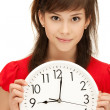 Teenage girl holding big clock — Stockfoto #5855338