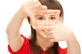Teenage girl creating a frame with fingers — Stock Photo
