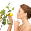 Lovely woman with lemon twig — Stock Photo #5869121
