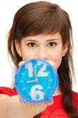 Teenage girl holding alarm clock — Stock Photo