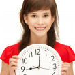 Teenage girl holding big clock - 图库照片