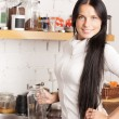 Lovely housewife at the kitchen - Stock Photo
