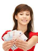 Teenage girl with euro cash money — Stock Photo