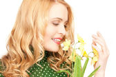 Lovely housewife with flower — Stock Photo